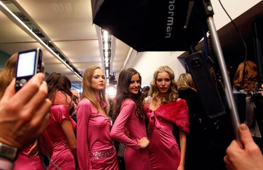 Models pose for photographers as they wait to enter the catwalk for the Seduzioni Diamonds Valeria Marini Fall/Winter 2010/11 women's collection during Milan Fashion Week February 24, 2010.        (REUTERS)