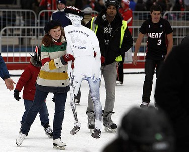 Claire Davies,14, skates with a cutout of Terry Fox during an Olympic Celebration at Nathan Phillips Square on Feb. 20, 2010. (DAVE ABEL, Toronto Sun)
