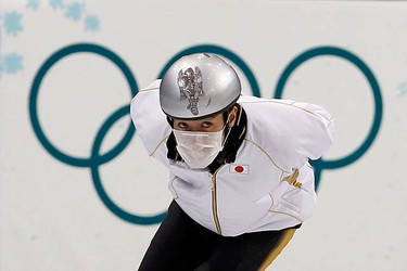Takahiro Fujimoto, of Japan, wears a face mask during a team training session in preparation for the short track speedskating competition at the Vancouver 2010 Winter Olympics on Feb. 8, 2010.  (REUTERS)