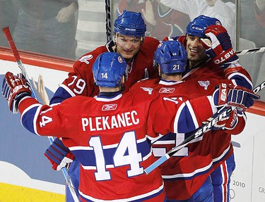 Montreal Canadiens Scott Gomez (R) celebrates his goal against Pittsburgh Penguins with team mates Brian Gionta (21), Andrei Markov (79) and Tomas Plekanec (14) during second period NHL hockey action in Montreal, on February 6, 2010.  (REUTERS)