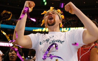 """Wingbowl 18 champion John """"Super Squibb"""" Squibb celebrates after eating 238 chicken wings to win the annual chicken wing eating contest in Philadelphia, Pennsylvania, February 5, 2010. (REUTERS)"""
