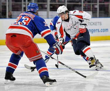 Washington Capitals left wing Alex Ovechkin tries to skate around New York Rangers defenseman Michal Rozsival (33) in the first period of their NHL hockey game at Madison Square Garden in New York on Feb. 4, 2010.  (REUTERS)