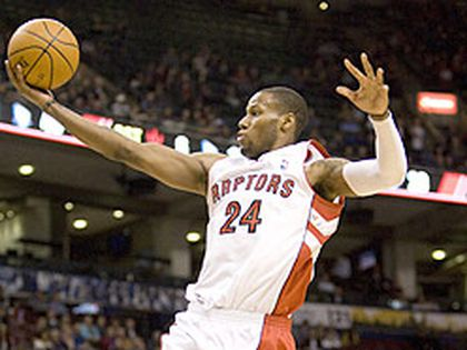 Raptors' Sonny Weems goes up for two of his career-high 14 points against the New Jersey Nets. (Stan Behal, Toronto Sun)