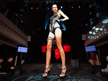 A lingerie model poses on the runway during a fashion show to promote Virgin Mobile Canada's new HSPA+ cell phone network in Toronto, February 2, 2010.  (REUTERS)