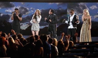 Jennifer Hudson (L-R), Celine Dion, Smokey Robinson, Usher, and Carrie Underwood sing tribute to Michael Jackson at the 52nd annual Grammy Awards in Los Angeles January 31, 2010. (REUTERS)
