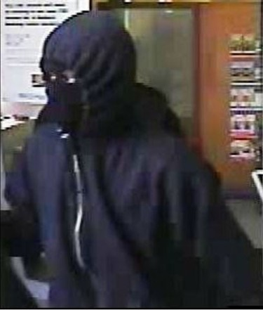 Three gun-toting bank robbers are being sought for three violent Toronto robberies in the last month during which three tellers were slugged on the head with a loaded pistol requiring stitches. (Toronto Sun/Jack Boland)