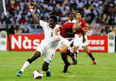Ghana's Asamoah Gyan (L) calls for a foul while being challenged by Egypt's Wael Gomaa during their Africa Cup of Nations final in Luanda on Jan. 31, 2010. (REUTERS)
