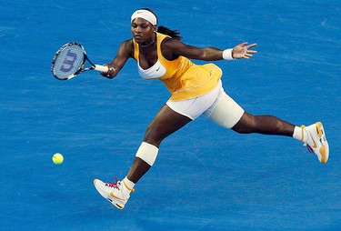 Serena Williams of the U.S. hits a return against Belgium's Justine Henin during their women's singles final at the Australian Open tennis tournament in Melbourne on Jan. 30, 2010.  (REUTERS)