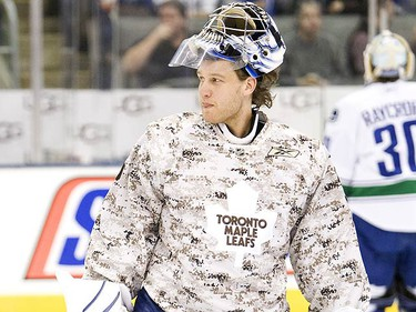 The Toronto Maple Leafs take part in their pre-game skate in camo sweaters before their NHL game with the Vancouver Canucks on Jan. 30, 2010. (GREG HENKENHAF, Toronto Sun)