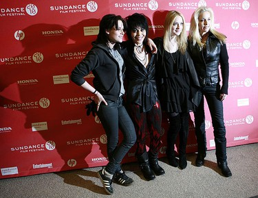 """Musician and producer Joan Jett (2nd L) is joined by cast members Kristen Stewart (L), Dakota Fanning (2nd R) and  producer Cherie Currie as they arrive for the premiere of the film """"The Runaways"""" at the Sundance Film Festival in Park City, Utah Jan. 24, 2010. REUTERS/Robert Galbraith"""