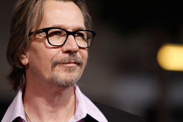 """Cast member Gary Oldman poses at the premiere of the movie """"The Book of Eli"""" at the Grauman's Chinese theatre in Hollywood, California January 11, 2010. The movie opens in the U.S. on January 15.  (REUTERS)"""