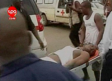 An unidentified man is moved to a hospital in Cabinda on Jan. 8, 2010, in this video grab obtained from Angolan. Gunmen opened fire on a bus carrying Togo's national soccer squad to the top African tournament in Angola on Friday, killing the driver and wounding nine others, including two players, a Togo team official said. (REUTERS)