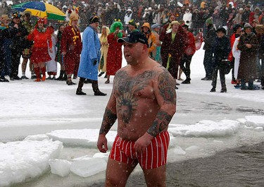 A member of an ice swimming club takes a dip in the frozen lake Orankesee in Berlin during the annual carnival swimming meeting on Jan. 9, 2010. (REUTERS)