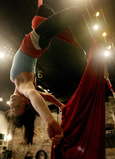 """Jen Georgopoulos, a Zero Gravity Performer on the """"Silks"""" as Montreal's National Circus School makes it's stop at the Zero Gravity Circus Space January 5th, 2010. (Dave Abel/Toronto Sun)"""
