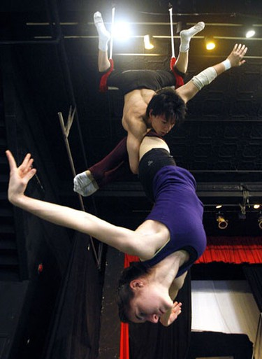 Peter Loung and Dora Yudeikin, Zero Gravity Performers on the trapeze as Montreal's National Circus School makes it's stop at the Zero Gravity Circus Space January 5th, 2010. (Dave Abel/Toronto Sun)
