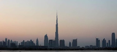 Photos of the Burj Dubai, the world's tallest tower, in Dubai on Jan. 3, 2010. Started at the height of the economic boom and built by some 12,000 labourers, the world's tallest building will open on Monday in Dubai standing at around 800 metres. (REUTERS)