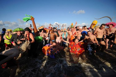 People wearing costumes pose in the water during the traditional New Year's Day swim in Malo-les-Bains, northern France January 1 2010. (REUTERS)
