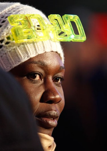 A woman wears a pair of 2010 glasses during New Year's Eve celebrations in New York's Times Square, December 31, 2009. (REUTERS)