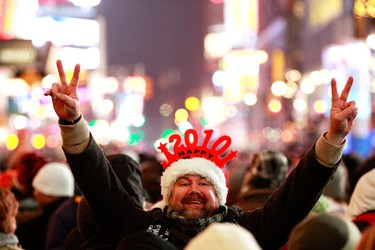 A reveller gestures during New Year's Eve celebrations in New York's Times Square December 31, 2009. (REUTERS)