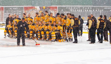 The Boston Bruins pose for their team photo on an ice rink setup in Fenway Park in Boston, Massachusetts December 31, 2009, ahead of the NHL's Winter Classic hockey game to be played January 1, 2010. (REUTERS)