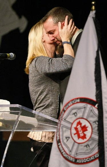 Rex Heath's son and daughter, Nadine and Brian support each other during their speeches. (Toronto Sun/Greg Henkenhaf)