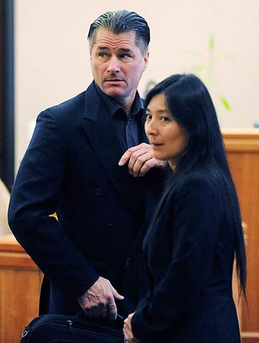 Richard (C) and Mayumi Heene (R) at their sentencing hearing in Fort Collins, Colorado on Dec. 23, 2009. The parents of a Colorado boy thought to have floated away in a homemade helium balloon are being sentenced on criminal charges of staging the incident in a publicity-seeking hoax.  (REUTERS)