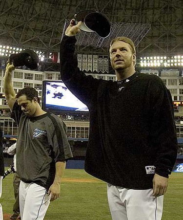 Roy Halladay; Frank Catalanotto - Blue Jays ace Roy Halladay and Frank Catalanotto say good-bye to the fans at the Rogers Centre at the end of the 2006 season. (Fred Thornhill/Toronto Sun Files)