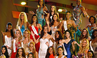 Miss England Katrina Hodge (centre, with hand raised) takes part in the Miss World finals in Midrand, outside Johannesburg, on Dec. 12, 2009. (REUTERS)