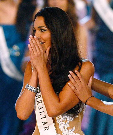 Miss Gibraltar Kaiane Aldorino reacts after being named Miss World during the Miss World finals in Midrand, outside Johannesburg, on Dec. 12, 2009. (REUTERS)