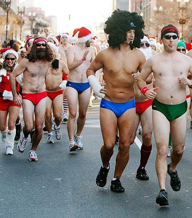 Participants line the streets during the 10th annual Santa Speedo Run in Boston, Massachusetts on Dec. 12, 2009. Proceeds from the 1.25 mile through Boston's Back Bay will benefit local charities.  (REUTERS)