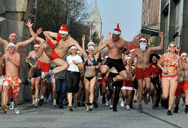 """People take part in a half naked """"Santa run""""""""in Budapest December 6, 2009. (REUTERS)"""