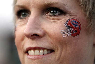 Michele Hubert shows her Bills pride during the Official Budwieser Tailgate party under the CN Tower on Bremner Rd before the Bills vs Jets NFL Game at the Rogers Centre on Dec. 3, 2009. (DAVE ABEL, Sun Media)