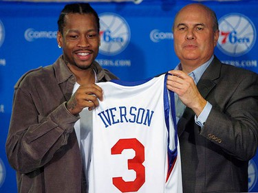 Philadelphia 76ers guard Allen Iverson (L) holds his jersey with 76ers president and general manager Ed Stefanski during a news conference announcing Iverson's return to the 76ers in Philadelphia, Pennsylvania on Dec. 3, 2009. (REUTERS)