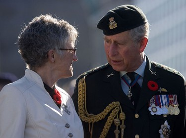 National Silver Cross Mother, Della Morley, left, speaks with Prince Charles, after the military parade passed along Wellington St. during the Remembrance Day ceremony at the National War Memorial in Ottawa Wednesday, November 11, 2009.   (DARREN BROWN/Sun Media)