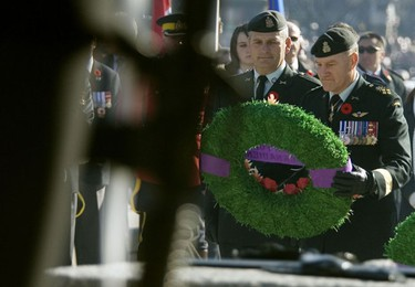 Canadian General Walter Natynczyk, right, lays a wreath during the Remembrance Day ceremony at the National War Memorial in Ottawa Wednesday, November 11, 2009.   (DARREN BROWN/Sun Media)