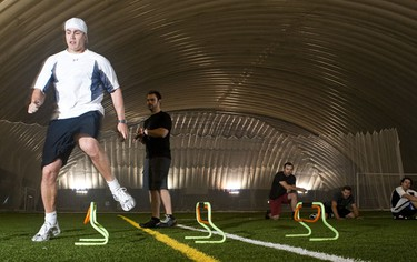 Canadian Alpine Ski Team member Erik Guay  does a drill as head conditioning coach Matt Price (L), Julien Cousineau, Ryan Semple and Patrick Biggs look on during a workout at the Athletic Conditioning Centre in Ottawa on Tuesday August 25,2009. (ERROL MCGIHON/SUNMEDIA)