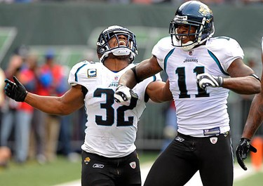 Jacksonville Jaguars running back Maurice Jone-Drew (32) and wide receiver Mike Sims-Walker (11) celebrate after Sim-Walker caught a pass and ran for a touchdown against the New York Jets in the second quarter of their National Football League game in East Rutherford, New Jersey, on Nov. 15, 2009. (REUTERS)