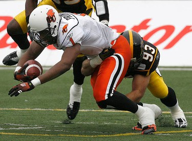 B.C. Lions quarterback Casey Printers is sacked by Hamilton Tiger-Cats defensive lineman Matt Kirk (R) during the first half of their CFL Eastern semi-final football game in Hamilton, on Nov. 15, 2009. (REUTERS)
