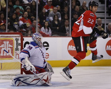 Ottawa Senators' Chris Kelly jumps in front of New York Rangers' goalie Henrik Lundquvist during first period action at Scotiabank Place in Ottawa Saturday afternoon. Tony Caldwell/Sun Media