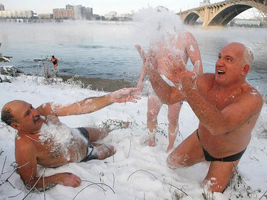 Members of a local winter swimmers' club stand on the bank of the Yenisey River, with the air temperature at around -17 degrees Celsius (1.4 degrees Fahrenheit), during the opening of winter bathing season in the Siberian city of Krasnoyarsk on Nov. 7, 2009.  (REUTERS)