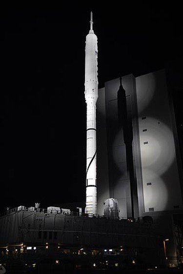 The towering 327-foot-tall Ares I-X rocket moves away from the Vehicle Assembly Building for launch pad 39A at NASA's Kennedy Space Center in Cape Canaveral, Florida Oct. 20, 2009. REUTERS/NASA/Handout