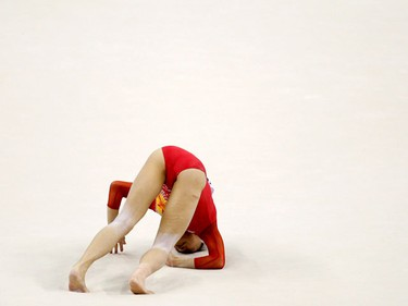 Kyoko Oshima of Japan falls during her floor routine at the qualifying round of the Gymnastics World Championships at the O2 Arena in London October 14, 2009. (REUTERS)