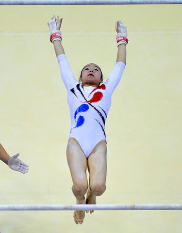 Eunhui Eum of South Korea falls from the uneven bars as she performs her routine during the qualifying round of the Gymnastics World Championships at the O2 Arena in London October 14, 2009.  (REUTERS)