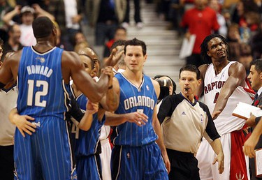 Bosh shrugs off Howard's complaint about being fouled. The Raptors lost to the Magic 125-116. (CRAIG ROBERTSON, Sun Media)