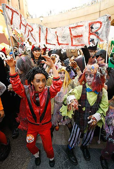 Children dressed as Michael Jackson (red) and other characters in Jackson's 'Thriller', dance at a Halloween parade in Kawasaki, south of Tokyo, on Oct. 31, 2009. About 3,000 people dressed in costumes took part in the Halloween parade. (REUTERS)