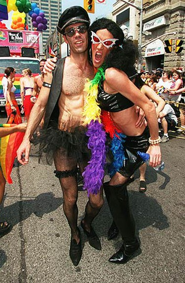 A file photo from 2002 of costumed pals showing that anything goes at Toronto's Pride Parade. (CRAIG ROBERTSON, Sun Media)