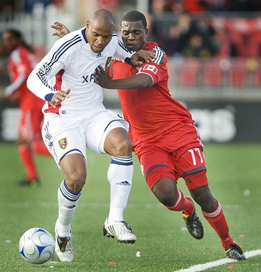 Toronto FC's O'Brian White and Real Salt Lake's Jamison Olave compete for the ball at BMO Field on Oct. 17, 2009. (ERNEST DOROSZUK, Sun Media)