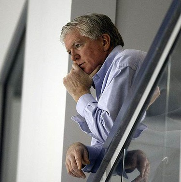 Brian Burke checks out the activity as the Leafs loosen up at practice on Oct. 15, 2009 at the MasterCard Centre. (MICHAEL PEAKE, Sun Media)