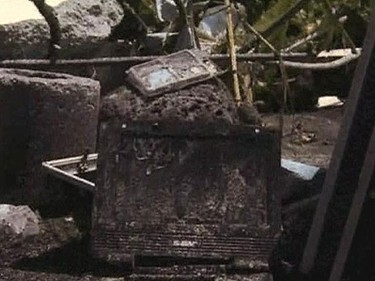 A personal DVD player is seen among the wreckage after a tsunami hit Western Samoa Sept. 29, 2009.    REUTERS/Reuters TV