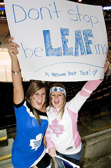 Leafs fans Amanda Cunningham (left) and Cait Woodroofe show they still have high hopes for their favourite team last night at the ACC. The Leafs lost to Colorado, 4-1. (GREG HENKENHAF/Sun Media)